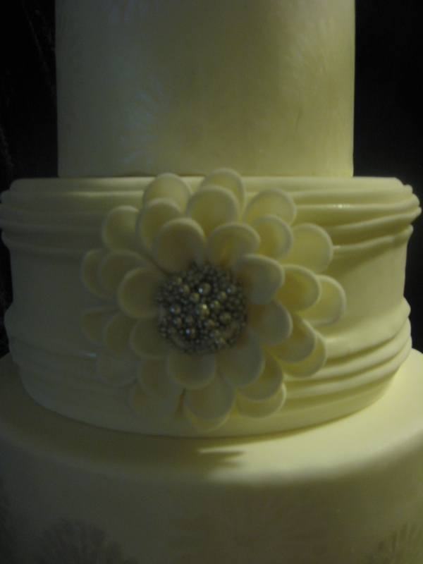 Silver and white stenciled wedding cake